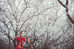 Blooming garden and asian woman