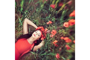 Woman in flower poppy field in summer