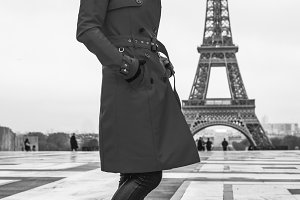 young woman against Eiffel tower in Paris, France