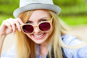 Portrait of happy hipster girl wearing sunglasses