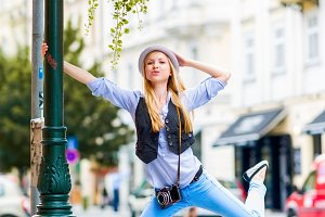 Happy hipster girl having fun on city street