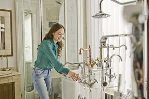 Woman looking faucets