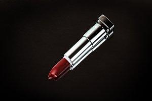 Open dark red lipstick