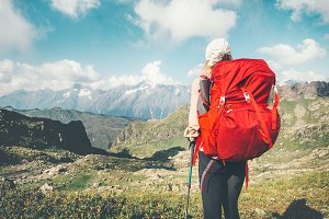 Woman hiking vacations at mountains