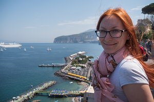 Red hair Girl in glasses traveling in Europe Italy - sorrento