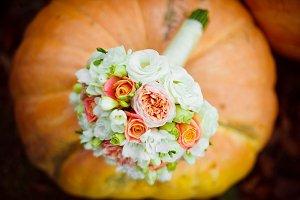 Wedding bouquet lying on the pumpkin