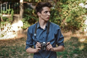 Teenage boy with retro camera