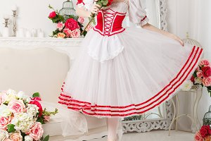 Cute ballerina holding flowers