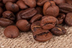 coffee beans on sackcloth close-up macro