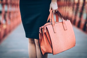 Crop shot of woman with bag