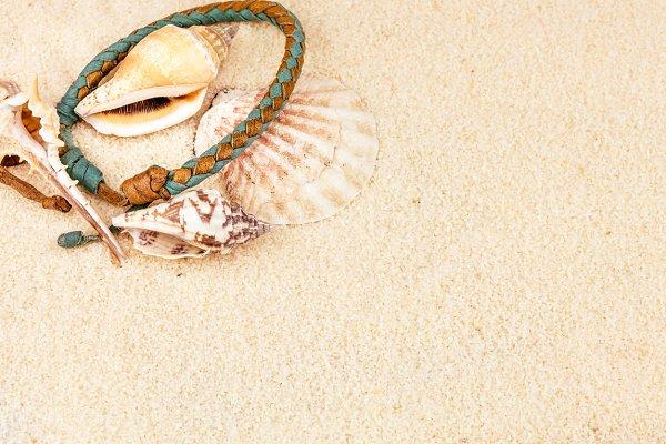 Sea shells and coloured wristbandon…