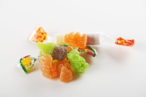 Candies and sweets of various flavors. Isolated. Horizontal shoot.