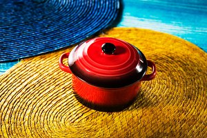 Red pot on blue wooden desk