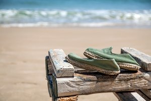 Shoes on table at beach