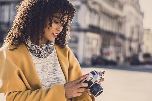 Charming woman with vintage cam