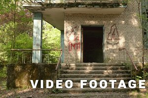 Entrance of the abandoned house. Smooth and slow dolly shot