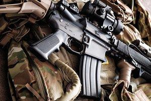 M4A1 (AR-15) tactical carbine on the bulletproof vest