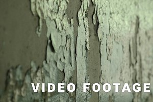 Broken wall in the abandoned factory. Smooth and slow dolly shot