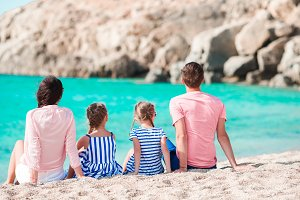 Young beautiful family on the beach