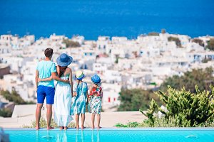 Family of four with beautiful view in luxury hotel