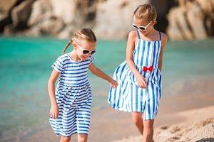 Adorable little girls during summer vacation. Kids enjoy their travel in Greece