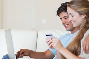 Portrait of a couple shopping online