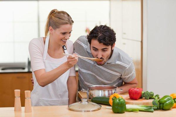Charming couple preparing a sauce