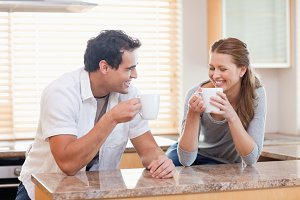 Couple having some coffee in the kitchen
