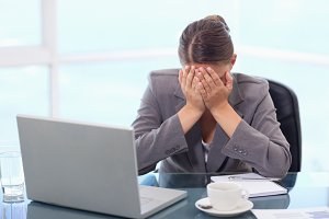 Frustrated businesswoman crying