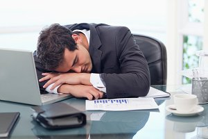 Tired businessman sleeping