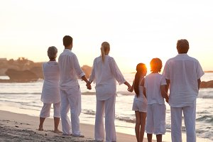 Family at the beach during the sunset