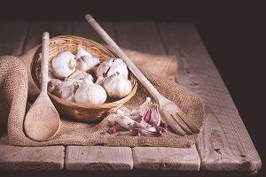 basket of garlic on table wood