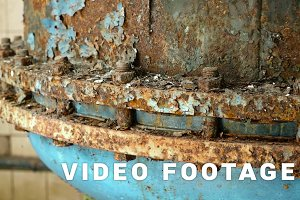 Rusted nuts of the boiler in the abandoned factory. Smooth and slow dolly shot