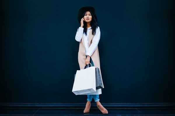 Asian girl with a blank paper bags