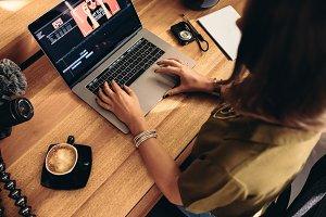 Female vlogger editing her vlog