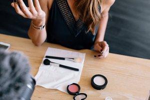 Female vlogger recording a make-up