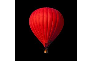Red air balloon isolated on black