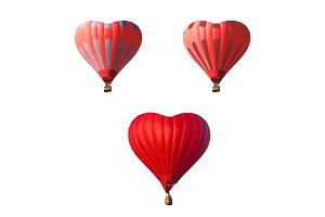 Red air balloons set in the shape of a heart isolated on a white background