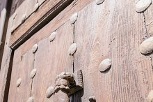 rusty hand shaped knocker
