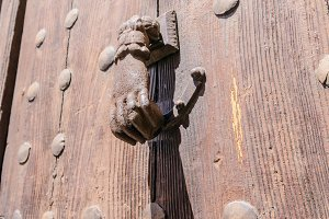 rusty hand shaped knocker