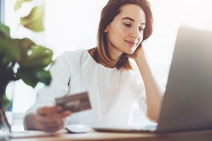 Business woman using credit card