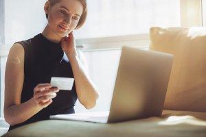 Smiling girl shopping online