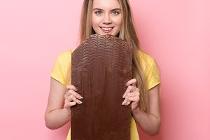 Woman with chocolate smiling