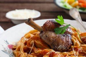 Italian pasta plate Tagliatelle with rabbit ragout, close view
