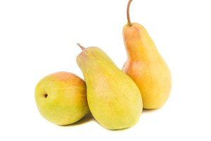 Heap of raw yellow pears, isolated