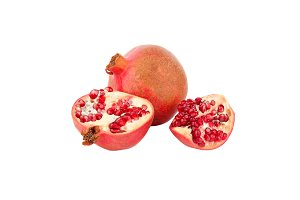 Whole and a half of pomegranate isolated on white