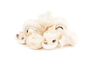 Raw white mushrooms, isolated on white