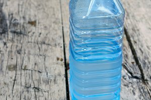 Bottle of water in blue