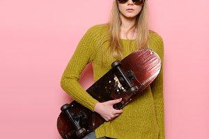 hipster girl holding skateboard