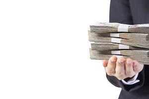 Business woman holding Thai money